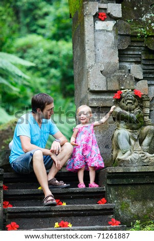 Happy father and his adorable little daughter in Bali - stock photo