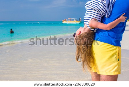 Happy father and his little cute girl enjoy summer vacation at perfect beach - stock photo