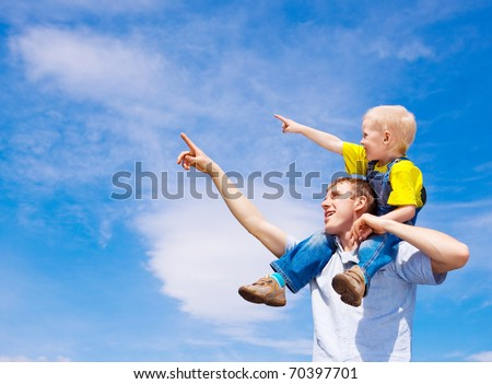 happy father and his son with balloons outdoor on a summer day - stock photo