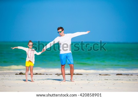 Happy father and kid together on white tropical beach - stock photo