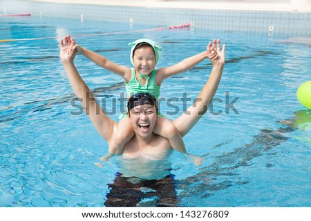 happy father and little girl in the swimming pool - stock photo
