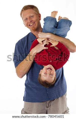 Happy father and small son playing and giggling