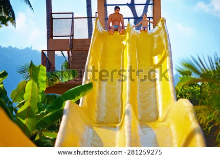 happy father and son are ready to slide in tropical aqua park - stock photo