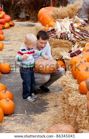 happy father and son at the pumpkin patch
