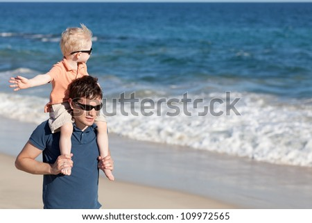 happy father and son at the tropical beach - stock photo