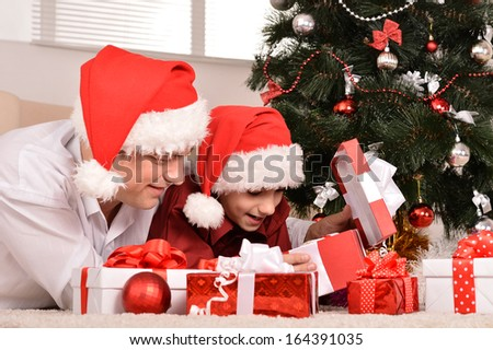 Happy father and son celebrating the New Year at home - stock photo