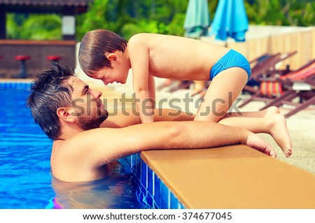 happy father and son enjoy summer vacation in pool - stock photo