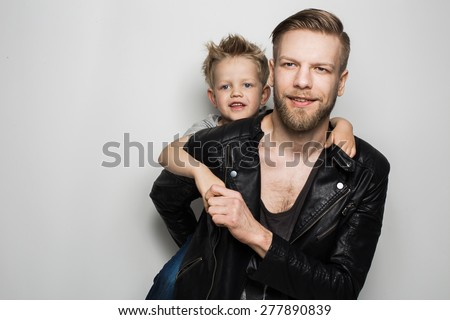 Happy Father and Son. Fathers day. Studio portrait over white background - stock photo