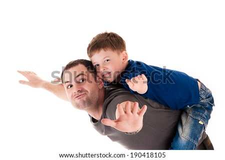 happy father and son flying - stock photo