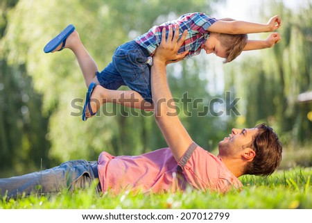 happy father and son fun - stock photo