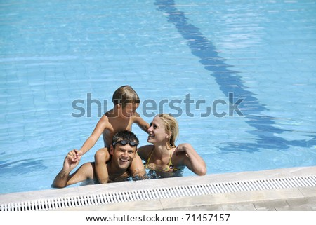 happy father and son have fun at swimming pool - stock photo