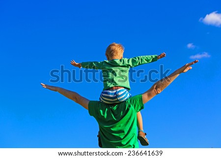 happy father and son having fun on sky - stock photo