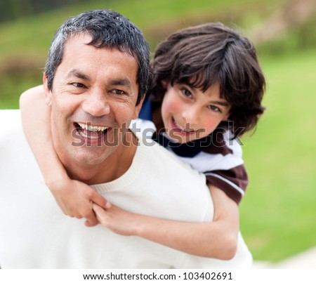 Happy father and son having fun outdoors - stock photo