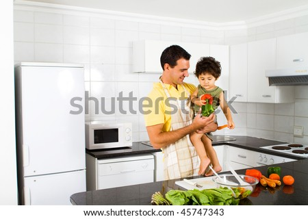 happy father and son in modern kitchen