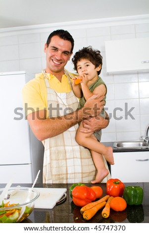 happy father and son in modern kitchen - stock photo