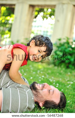 Happy father and son in park - stock photo