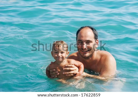 happy father and son in water
