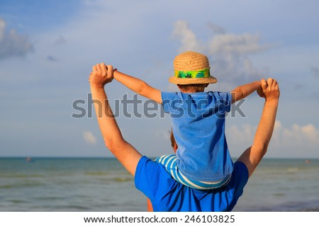 happy father and son on sky at sea - stock photo
