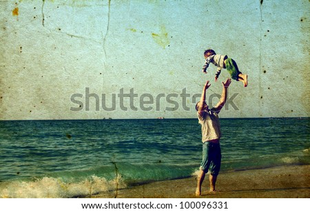 Happy father and son on the beach - stock photo