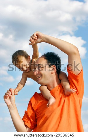 happy father and son outdoors - stock photo