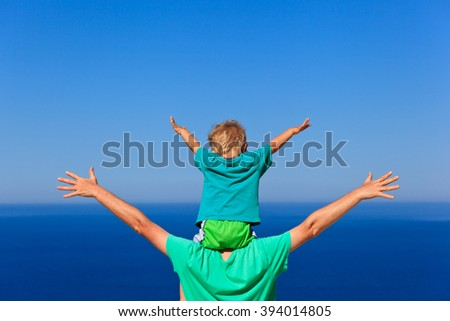 happy father and son play at sky - stock photo