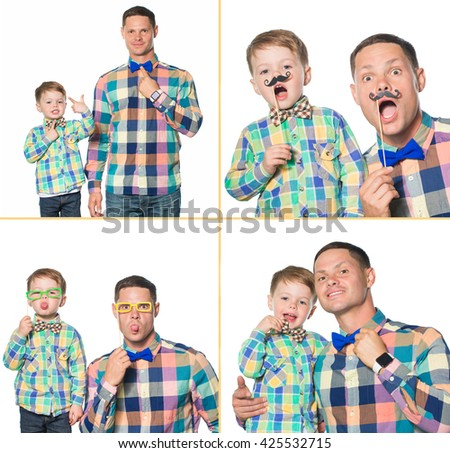 Happy father and son playing in studio isolated on white - stock photo