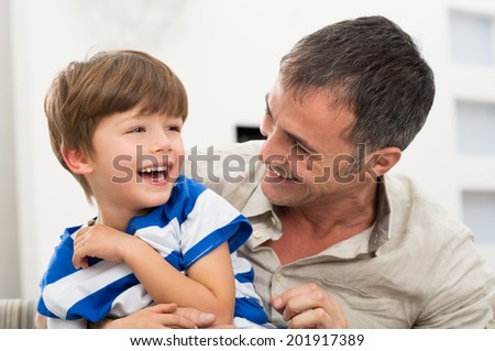 Happy Father And Son Playing With Each Other - stock photo