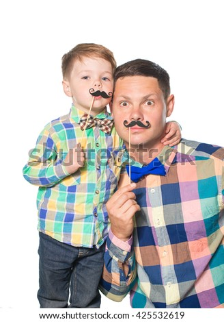 Happy father and son playing with paper mustache isolated on white - stock photo