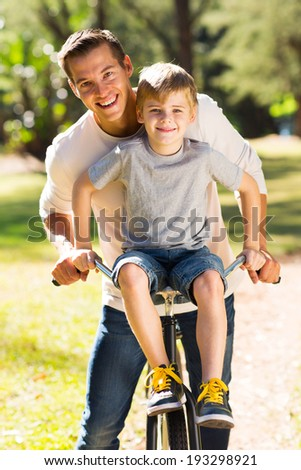 happy father and son spending quality time together in the park - stock photo