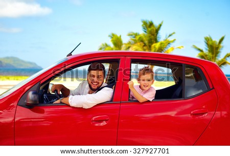 happy father and son traveling in the car on summer vacation - stock photo
