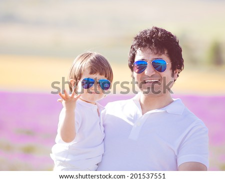 Happy father and son with aviator blue mirrored sunglasses, partner look, having vacation in Provence - stock photo