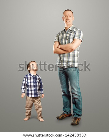 Happy father business man with little baby son - stock photo