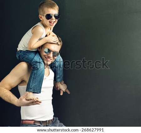 Happy father carrying his son - stock photo