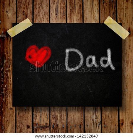 Happy Father Day note on message note with wooden background - stock photo