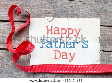 Happy father day on aged paper on wooden background - stock photo
