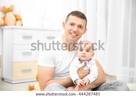 Happy father holding baby