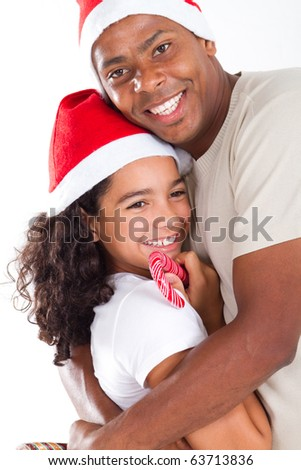 happy father hugging daughter wearing christmas hat - stock photo