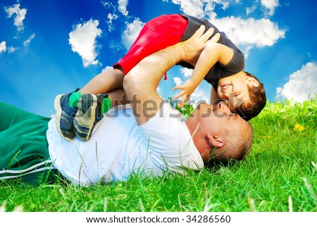 Happy father or grandfather and son on beautiful background - stock photo