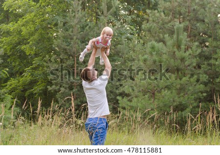 Happy father playing with his little daughter
