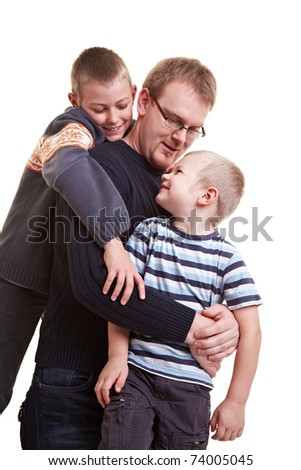 Happy father roughhousing with his two sons - stock photo