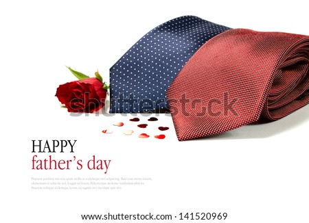 Happy Father's Day concept image with two smart generic business man's ties folded with hearts and a red rose against a white background. Copy space. - stock photo
