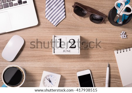 Happy father's day. Top view Greetings card of desk with laptop, tie, coffee cup, notebook, pen, calendar and smartphone on wooden backround. - stock photo