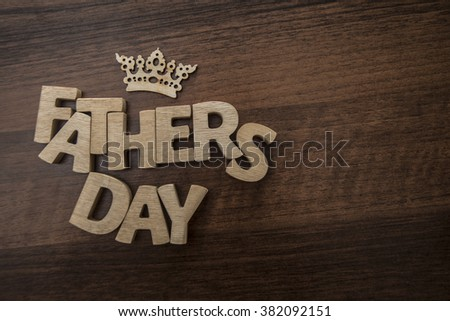 Happy Father's Day - Wood letters- wooden crown above words - stock photo