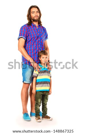 Happy father standing with his little son. Isolated over white.