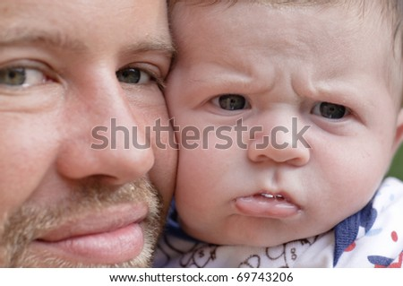 Happy father with angry baby. - stock photo