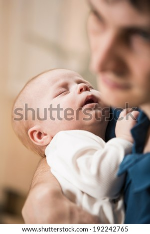 Happy Father with baby in his arms