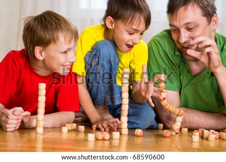 happy father with children playing on the floor