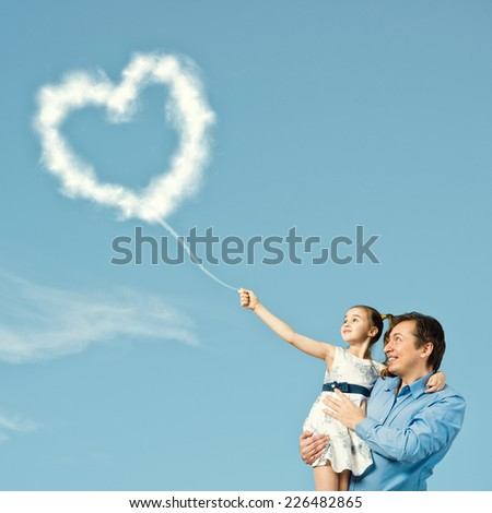 Happy father with cute daughter on hands - stock photo