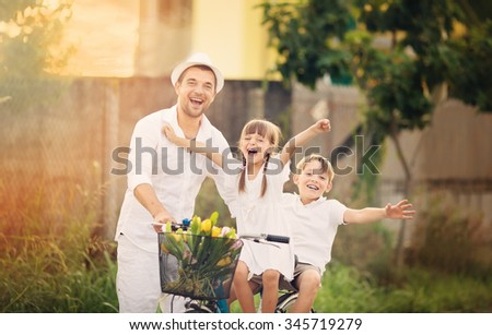 happy father with daughter spending quality time together outdoors - stock photo