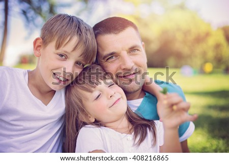 happy father with daughter spending quality time together outdoors